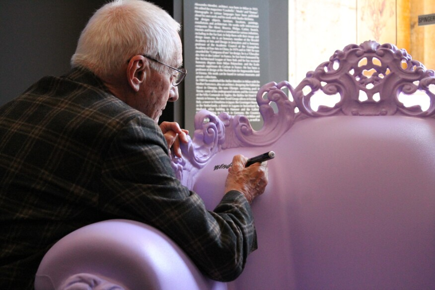 "Alessandro Mendini signs the special edition ""violato"" Magis Proust armchair on May 10, at the opening of the 2015 D'Annunzio e i Giardini di Pan, that is taking place the Brescia province of Italy until Oct. 31."