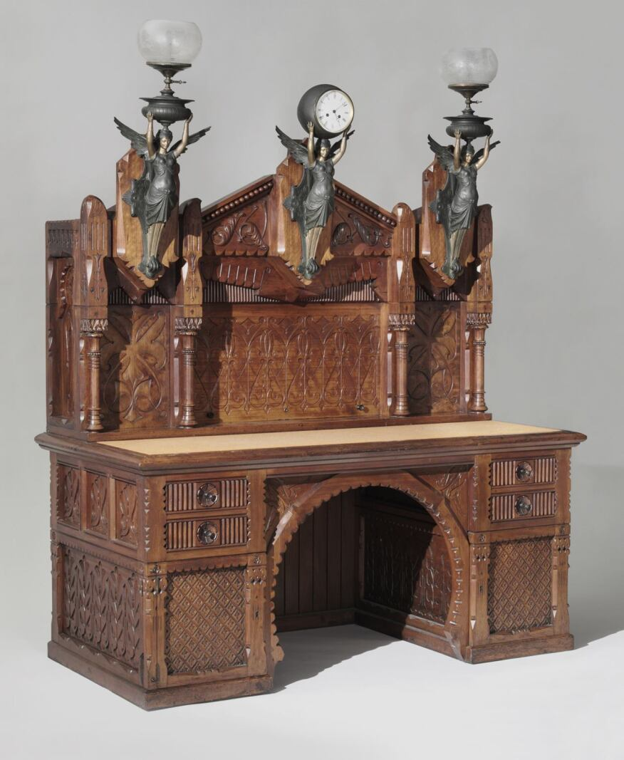 Desk, designed by Frank Furness, American, 1839-1912. Possibly made by Daniel Pabst, American (born Germany), 1827-1910. Philadelphia, c. 1875, Walnut, white pine, maple, poplar, with clock and lamp mounts and glass globes. Made in Philadelphia; gift of George Wood Furness, 1974.