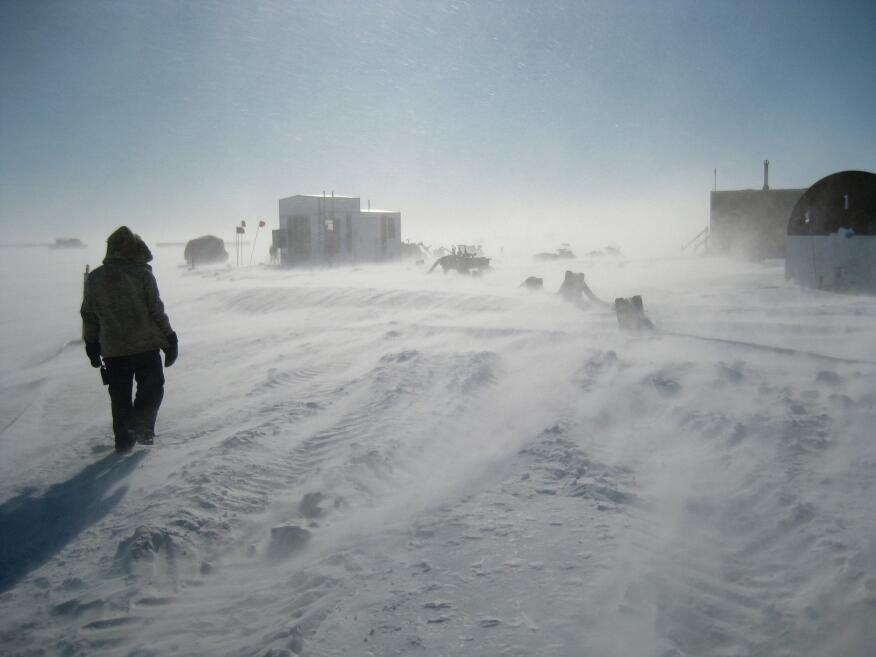 A scientist walks towards McMurdo's runway, for planes, made of sea ice.