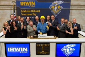 Trade worker Delwyn Thornton rings the bell to open the New York Stock Exchange on Sept. 1, 2011 to celebrate National Tradesmen Day.