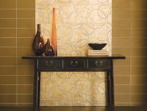 The Tracciato Collection of luxury tiles features decorative etchings hand-laid with genuine gold and silver leaf, then hand-waxed and buffed to a natural patina. Two styles are available: silver-leaf etching on dark gray limestone or white marble with gold leaf. Walker Zanger, 818.504.0235;  www.walkerzanger.com