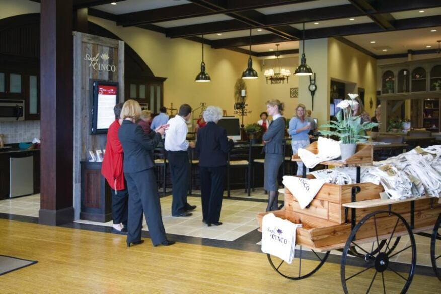 MEETING SPACE: Simply Cinco, the information center for Newland Communities' Cinco Ranch in Katy, Texas, builds traffic by hosting local groups, such as this Chamber of Commerce event.
