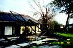 DAMAGE CONTROL: This home of an American Management Services employee took a hit from a hurricane.