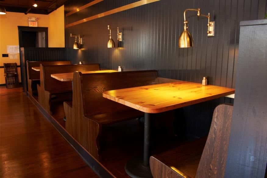 Visitors to the Great Lakes Brewing Co., in Cleveland, will see bar tables and stools stamped with the address from which the lumber was salvaged, a signature move by local furniture maker Reclaimed Cleveland.