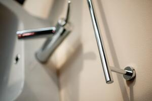 fine lines   Sleek simplicity distinguishes the Linea line of decorative hardware for the bath. Towel bars and rings, toothbrush holders, hooks, shelves, pulls, and soap dishes are available in polished chrome or brushed nickel. Atlas Homewares, 800.799.67