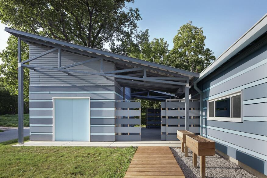 Reconfiguring the typical Heartland Habitat house layout allowed El Dorado to create an outdoor room between the house proper and the detached garage.