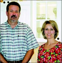 Bob Fleming and homeowner Becky Eubank