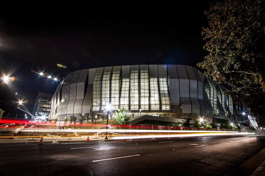 The arena features multiple full-height, glazed entrances.