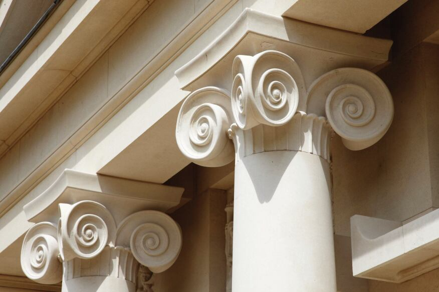 The ionic columns feature exagerrated volutes.