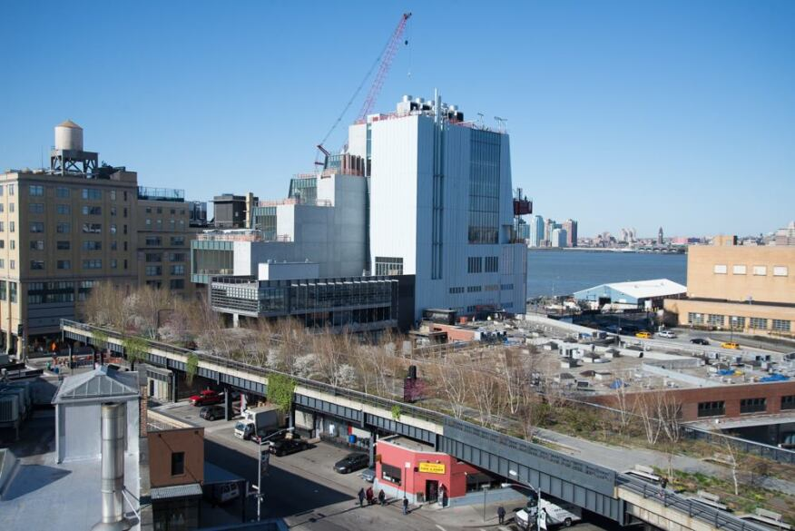 The new Whitney (view of the north and east sides of the building during construction in the spring) rises next to the High Line.
