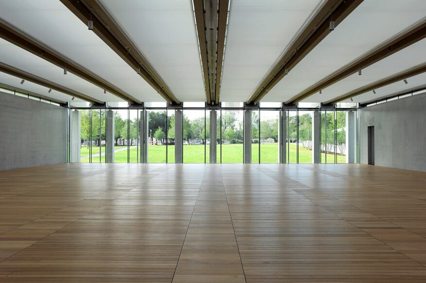 Interior of the South Gallery, with its laminated wood beams that support the scrim-covered fritted-glass roof. Photographed September 2013.