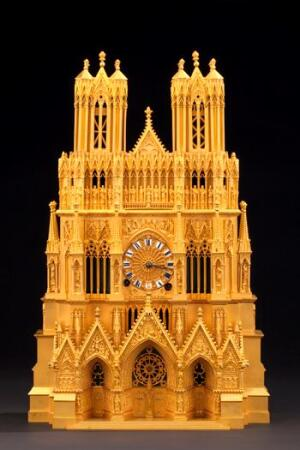 A gilded-bronze, porcelain, and enamel souvenir clock replica of the Remis Cathedral, Paris, France, c. 1820.