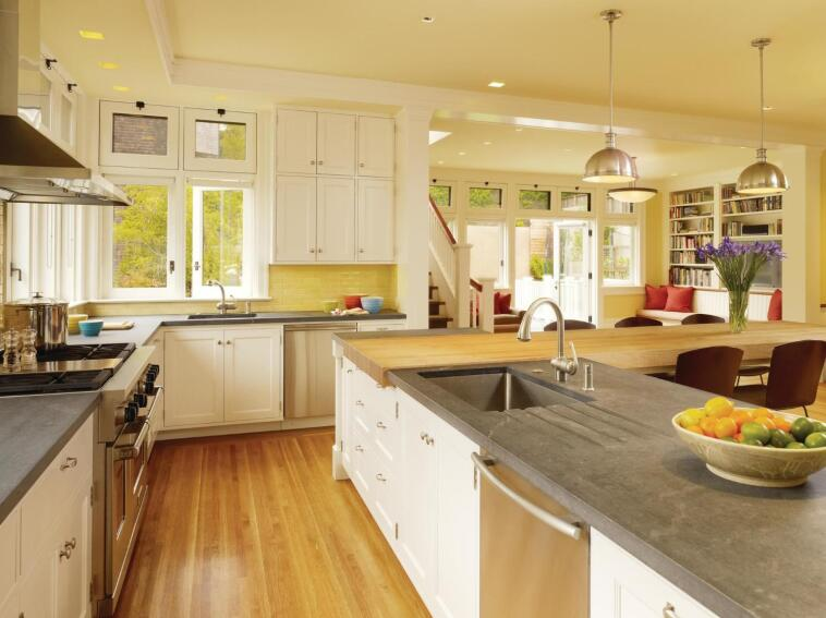 With its L-shaped floor plan, this multifunction kitchen offers a set of subtly overlapping zones.