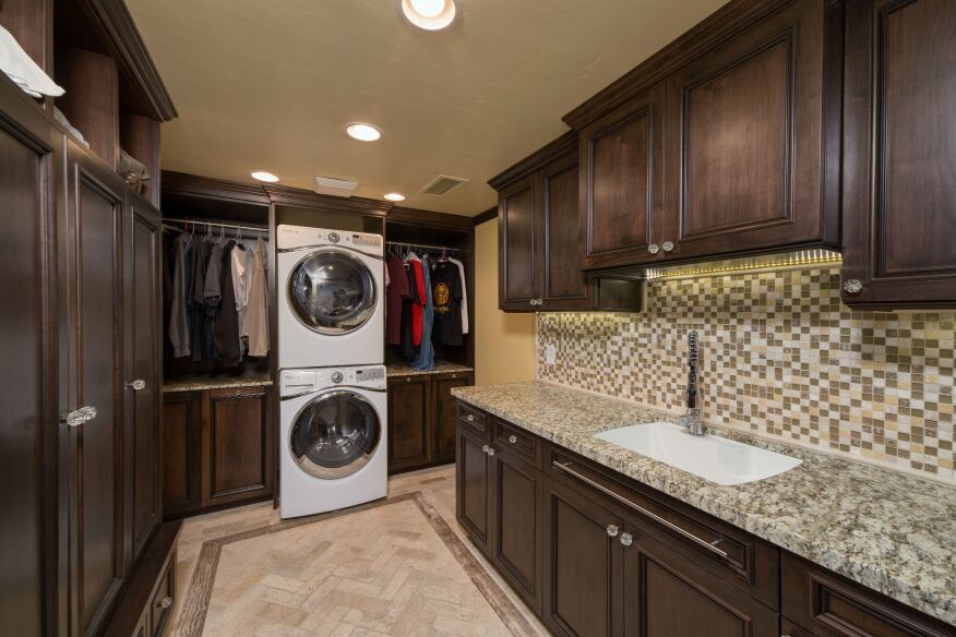 hochuli design remodeling team used popular materials like stone flooring custom cabinetry