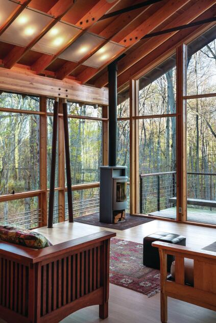 Since heat loss is a concern in the mountain climate, radiant floors and a custom radiator system of stainless steel tubes that run in front of the glazing are supplemented by a wood stove.