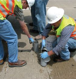 Virginia Department of Transportation workers take samples of the non-portland cement-based concrete for strength testing.