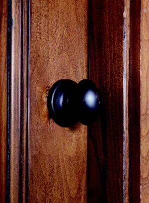 HOB KNOBS: All interior doors feature Kwikset Laurel egg knobs and Dorian deadbolts in  Venetian bronze by Black & Decker Hardware and Home Improvement. The interior  privacy knob features an anti-pick six-pin system, a decorative egg  shape, and concealed screws. Here, a dark finish complements the rustic appeal  of the house, but other finishes are available.