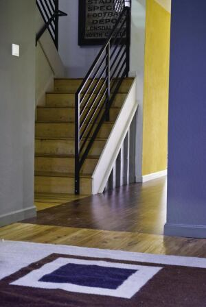 The stairs feature Restoration Timber's engineered reclaimed plank hickory.