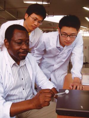 Timed Capsule Professor Darkwa (left) and research assistants examine phase-change material they've engineered to store and release a room's excess heat.