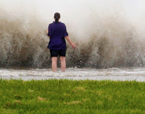 New Orleans resident Diana Whipple stands on the shore of Lake Pontchartrain as Tropical Storm Isaac approaches New Orleans, Louisiana, August 28, 2012.