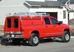 The truck is 2006 Dodge 2500 with a rack and a custom cap.