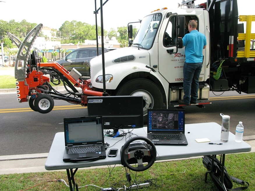 Royal Trucking & Equipment Inc. demonstrated the first autonomous work truck for the Florida DOT. A maintenance truck was equipped with a communications system developed for the military that enables a vehicle to precisely mimic another vehicle's path and speed. The truck was equipped with TrafFix Devices Inc.'s Scorpion attenuator attachment, which is designed to minimize injuries and equipment damage by absorbing the energy of a collision.
