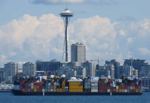 A barge leaves Seattle laden with goods Uresco was shipping to Alaska