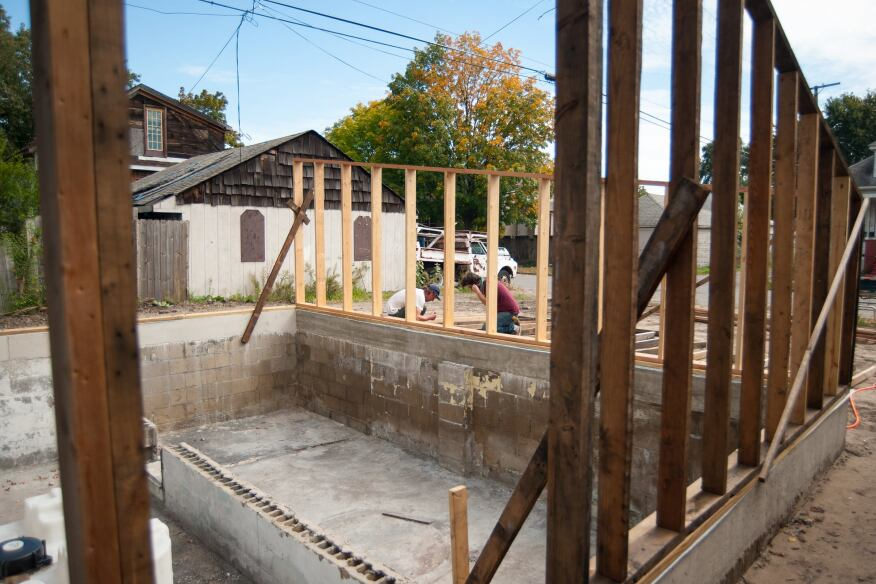 View of the Afterhouse and indoor planter beds from the northwest. Framing the building's walls, which support a roof that is specifically twisted 30 degrees from the street grid to maximize sunlight exposure, has served as a refresher course in geometry for the team.