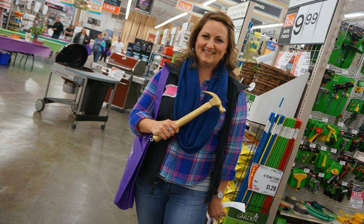 A customer shows off the Golden Hammer, good for a prize at Gillman Home Center