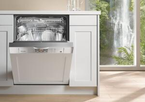 "Miele's new G 2002 series dishwashers meet 2011 Energy Star requirements and claim 17 percent greater water efficiency over previous models. The machines use 5.1 gallons of water for a ""normal"" cycle (down a gallon from other Miele dishwashers); the Economy cycle, by comparison, uses a mere 1.2 gallons of water. It comes in a Clean Touch Steel finish, which resists fingerprints and scratches. Miele, 800.843.7231;  www.mieleusa.com"