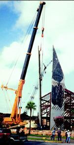 For the record books: Two 91-foot panels for a Texas church addition are lifted using a 650-ton crane with a 148-foot boom. Eight tractors and semis hauled the 309,000-pound counterweight (March 1998).
