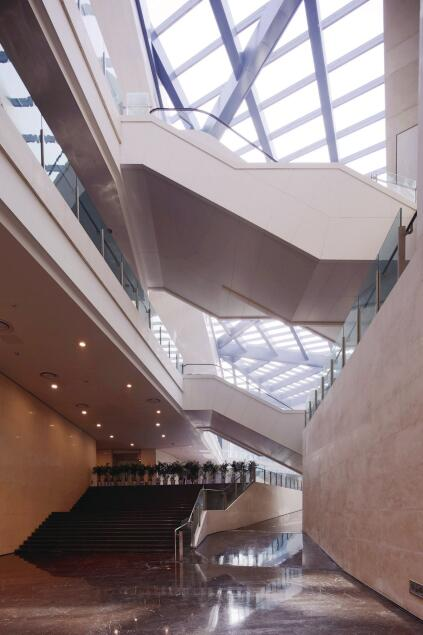 The circulation sequence, which involves a series of ramps and promenades, becomes evident in the Piranesian criss-crossing of staircases, seen here at the eastern edge of the atrium.