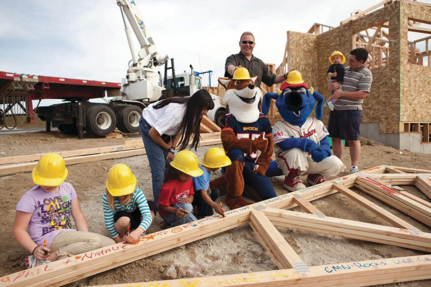 Miracle Home Kids help with the construction of a Children's Miracle Network home.