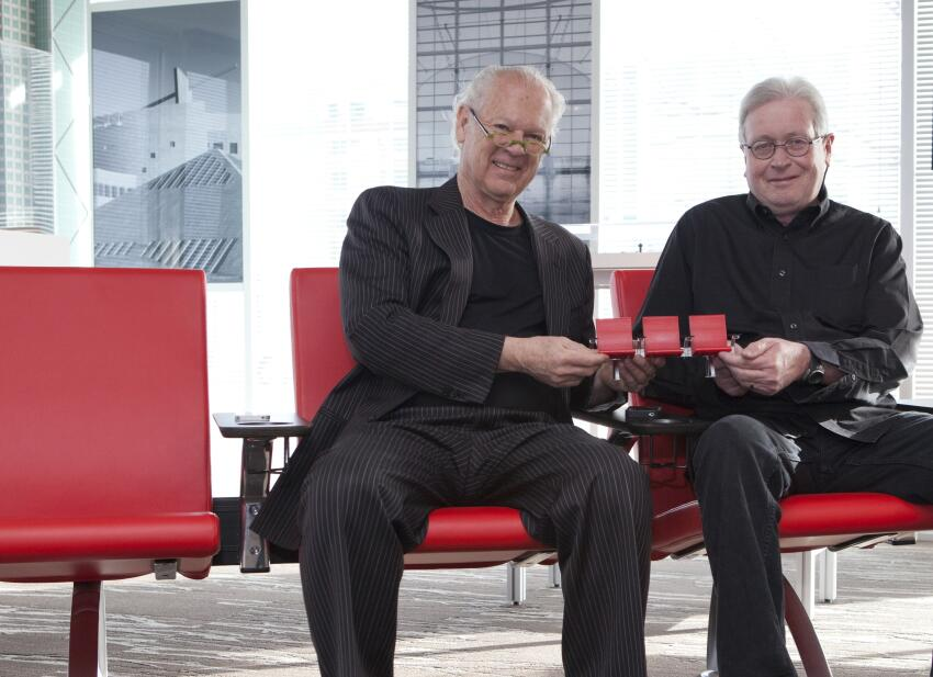 Curt Fentress (left), CEO and design principal at Denver-based Fentress Architects, teamed up with industrial designer Michael McCoy on a feature-packed airport seating system designed to meet the needs of today's travelers.