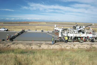 Castle Rock Construction Co. of Colorado replaced several miles of Peña Boulevard with 11-inch doweled concrete on a recycled stabilized road base. Their collaboration with the City and County of Denver, Denver International Airport, and Holcim (U.S.) Inc. resulted in a durable, smooth roadway with low environmental impact.