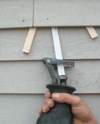 Figure 4. When prying doesn't free up the nail, putting wedges under the siding and using a metal- cutting blade will do the trick.