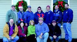 The public works department of Old Orchard Beach, Maine, stands ready to respond to harsh winter weather. Front, from left: Marc Picard, Robin Huguenin, Mary Ann Conroy, Tom Dupuis, Jamie Boynton. Back, from left: Dennis Poisson, Roger Stevens, Mike McCallum, Tim Crowley, Rick Reny, Mike Perrone, Jim Fish. Photo: Old Orchard Beach department of public works