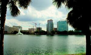 A block to the south, views from the shore of Lake Eola portray the city's ongoing condo boom and urban revitalization.