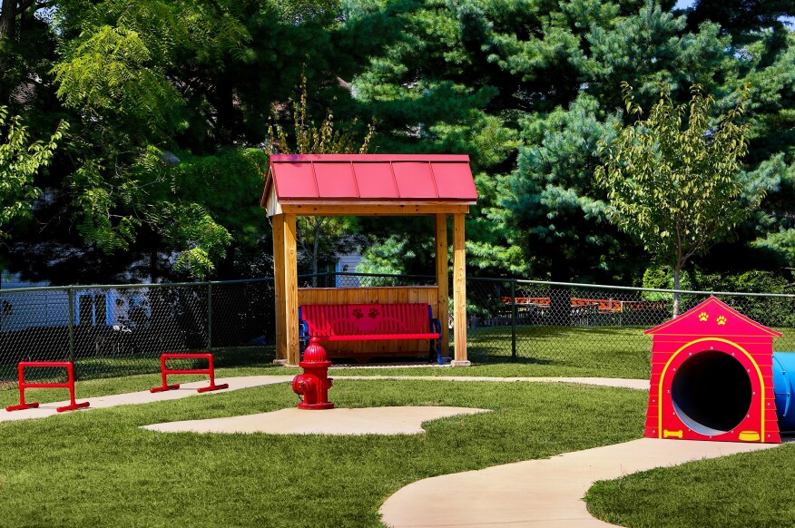 A dog park at Spring Parc in Silver Spring, Md. The ROSS property markets itself prominently as a pet-friendly apartment community.