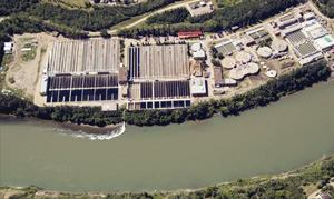 Effluent treatment plants such as the Gold Bar Wastewater Treatment Plant in  Edmonton, Alberta, from which the effluent stream can be seen above as a dark  color in the North Saskatchewan River water, need to deal with an expanding  range of compounds. Photo: City of Edmonton, Alberta, Canada