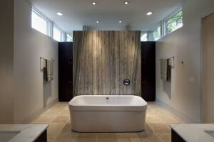 The centerpiece of this serene bath designed by Austin, Texas-based architect Jay Corder is a natural marble slab serving as a tub backsplash on one side and a shower wall on the other.  www.jaycorder.com
