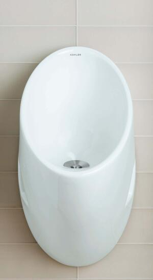 Steward waterless urinal    Kohlerwww.kohler.com  Saves up to 40,000 gallons of water per year compared to 1 gpf urinal - Reduces water, sewage, and maintenance costs - Virtually splash-free surface - 14-inch extended rim - Includes removable strainer, universal mounting bracket, outlet spud, hangers, and sample bottle of Kohler waterless urinal sealing liquid and cleaner