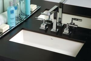 "The Undermounted Vanity Rectangular Lavatory sink, shown here with the polished-chrome Quadratta Lavatory Mixer faucet, is the latest basin from Duratex brand Deca. The fire-clay sink delivers a streamlined, modern look well suited for hospitality environments. Measuring 23 1/4"" long by 9 1/16"" wide by 6 5/16"" deep, the basin also features overflow prevention. deca-us.com"