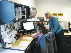 Billing clerks Mary Belleheumer and Mary Ginter update an account in Waterford Township's new Customer Information System.