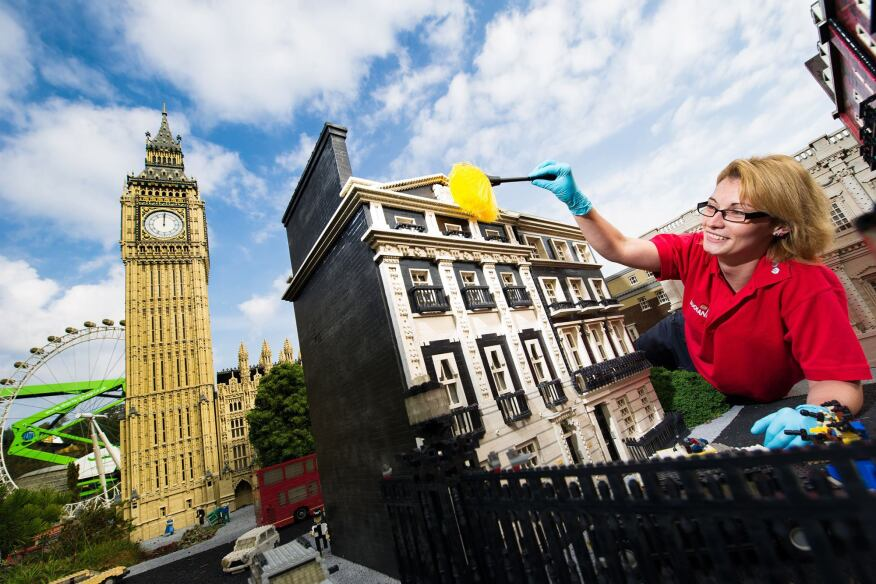 Model maker Katrina James dusts 10 Downing Street at Legoland Windsor Resort in England during the park's annual September cleaning.