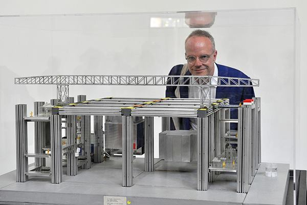 Hans Ulrich Obrist, curator of Switzerland's pavilionat the 2014 Venice Biennale, with a model of Cedric Price's Fun Palace.