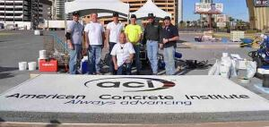 "Last year, ACI President Anne Ellis had the honor of presenting ACI's new ""Always Advancing"" logo on a large slab of pervious concrete. (Left to right) Nathan Mitchell, Bunyan Industries; Lonnie Gray, Research and Development Manager, Oldcastle, Salt Lake area; Justin, Caz, and John Bazella - Craftsmen; Jim Miller - Craftsman. Dave Mitchell, Bunyan Industries is in front."