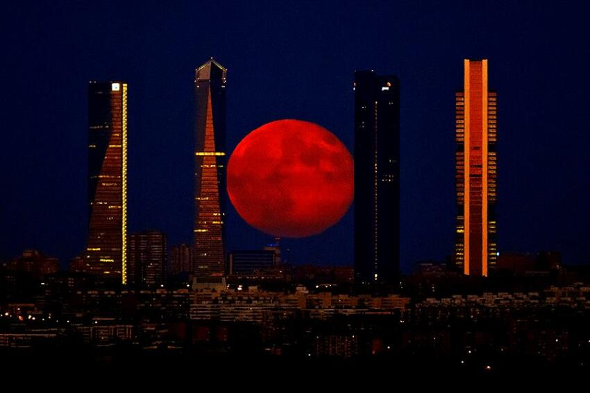 The moon over the Cuatro Torres Business Area in Madrid, Spain, on Monday.