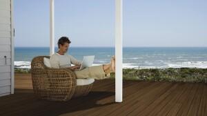 Man using laptop computer outdoors