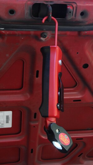 A retractable hook allows the tool to hang like a trouble light--but with a pivoting head that makes it easier to project the beam onto a particular area.